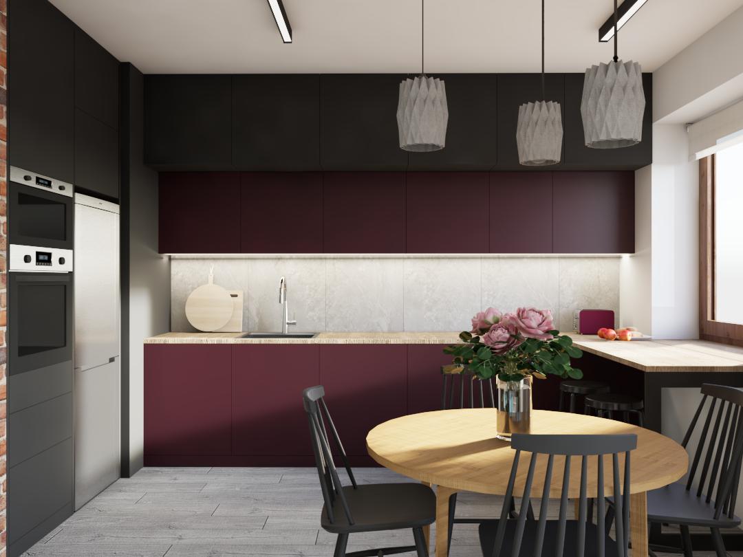 Projekt kuchni w kolorze grafitu i burgundu. Na pierwszym planie okrągły drewniany stół i czarne krzesła Fameg.